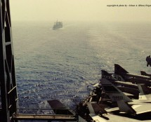 view from the USS NIMITZ with accompanying  ship giving signals (HE))