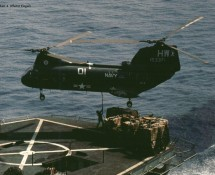 CH-46 Sea Knight , U.S.Navy. above replenishment-ship alongside the Nimitz (HE)